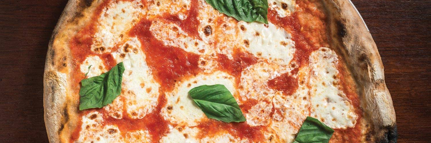 A delicious Margherita pizza with tomato and basil